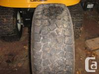 Four studded m/s tires on steel rims. Came off a ford