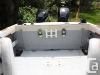 Twin Mercury Optimax outboards on pod. Engine hours