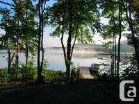 Lovely turn-key lakefront home with 3 season and