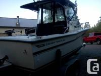 Very nice boat. LOA is closer to 30' with pod and