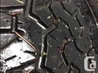 2 5 hole chevy half ton steel rims and 3 tires; 255 70