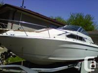 1980 Searay Sundancer.  Length: Approx. 27ft. long (Bow