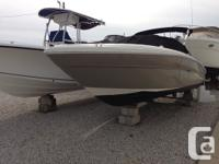 Very nice 220 select. Swivel captains seat with flip up