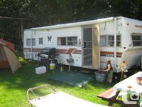 28 foot Shasta camper has its own bedroom at back,