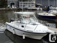 The Boston Whaler 23 Conquest features a reliable