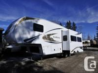 This beautiful pre-owned 5th wheel trailer came to us