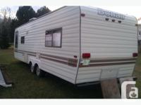 29 ft bonair camper with rear walkaround bedroom with