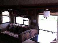 2012 COUGAR XLITE 29RBS, rear bunks (with kids tv area,