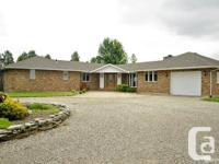 This is an executive-style ranch home set in the