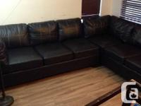 Black leather sectional with white cross-stitching