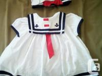 This is an adorable 3-6 month old white and blue Sailor