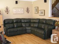 * 8 years old leather sectional in excellent condition