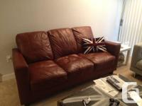For sale is an 3 seater brown real leather sofa in