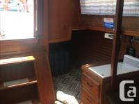 Well appointed 1983 Fraser Sloop. Forward V berth,