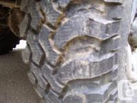Four 31x10.50r15 BFG Mud Terrain KM1 tires. Excellent