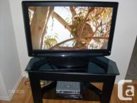TV works excellent with a great picture. The stand: