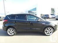 Description: This 2015 Ford Escape Titanium will change
