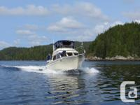 Amici is a rare Tollycraft Sundeck Cruiser with Teak