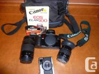 Canon EOS Elan  2 Zoom Lenses- 75-300mm and 35-80mm