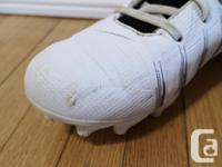 Size 6 Under Armour football cleats. We bought these