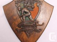 Copper plaque over brown and green felt. NATIONAL