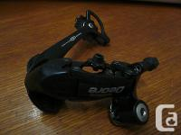 This item is a Shimano Deore RD-M530 SGS Rapid Rise