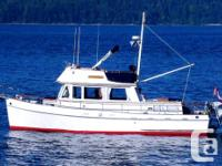 """""""Soo Valley"""", a 1971 Grand Banks 36 Classic, is an all"""