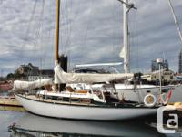 This is a beautiful classic sloop that has been