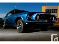 1969 Mustang Coupe Grande. Acapulco Blue w/ Black Vinyl