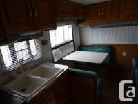 21.5ft. 5th wheel. Lots of cupboards, wardrobe. A/C, 2