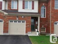 This new townhouse in vibrant Milton's beautiful