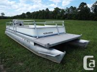 24' Crest pontoon boat with an Evinrude 40hp O/B. Has