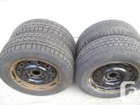 """Available is a collection of 4 winter 15"""" snow tires on"""