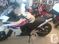 This beautiful CBR500 comes with a GIVY topbox, warmed