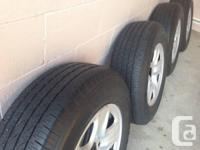 """Hi This is as new 4 michelin LTX A/S 18"""" tires and rims"""