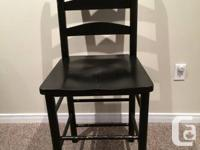We have 4 black wood high back chairs for sale, looking