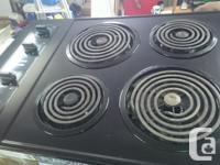 """Black 4 burner Kenmore Stove Top and Black 27"""" Kenmore"""