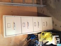 4 Drawer Filing Cabinet with hanging folders.  Good