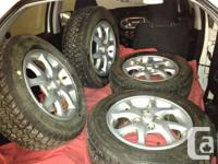 Four DUNLOP Winter max tires and aluminum alloy rims