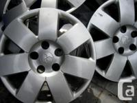 Selling 4 original hubcaps/wheel covers from my 06