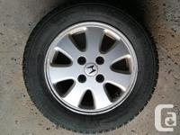 4 Mechelin X-Ice Snow Tires on Honda Alloy Rims,