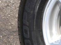 Set of 4 Mint All-Season Cooper Tires - CS5 Grand