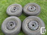 4 Motomaster AW 205/75R14 tires on steel rims with