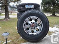 mounted and balanced on new aluminum 8 lug rims - with