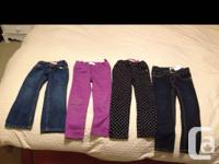 Four pairs of pants. Three on the left are size 4 (old