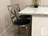 4 solid counter height swivel bar stools for sale. They