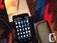This Nexus 4 Google Cell phone still has it's original