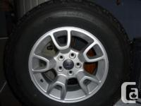 4 STUDED SNOW TIRES ON 5 TALKED WHEELS. ONLY 1000 KM.