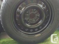 A set of 4 winter tires (KUMHO) on rims with built in