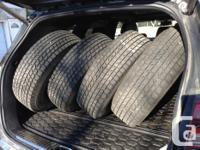 4 winter tires on black steel rims; Yokohama